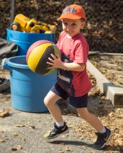 Boy running with a ball