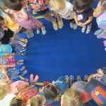 Kids standing in a ring at circle time