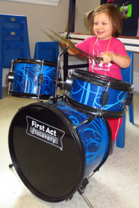 Girl banging on the drums